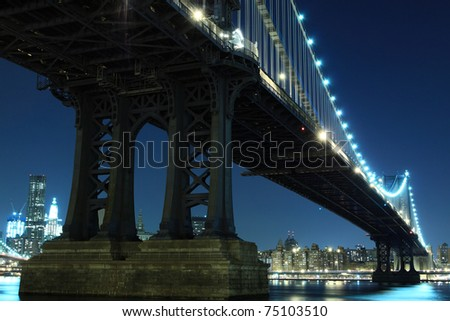 Manhattan Bridge and Manhattan skyline At Night Lights, New York City - stock photo