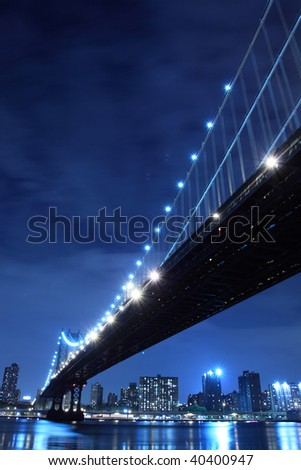 Manhattan Bridge and Manhattan skyline At Night Lights, NYC - stock photo