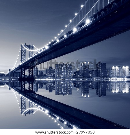 Manhattan Bridge and Manhattan skyline At Night, New York City - stock photo