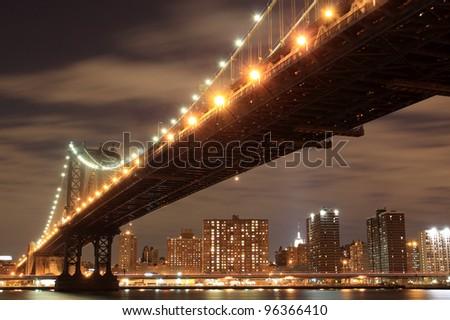 Manhattan Bridge and Manhattan skyline At Night, New York City - stock photo