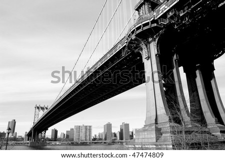 Manhattan Bridge and Manhattan skyline, New York City - stock photo