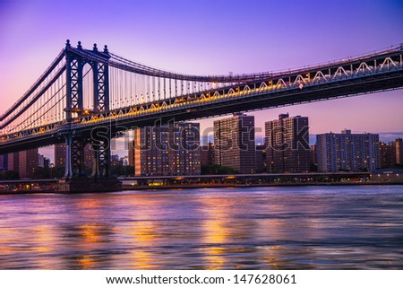 Manhattan Bridge and New York City at sunset - stock photo