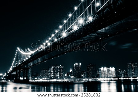 Manhattan Bridge and the East river seen from Brooklyn, New York. - stock photo