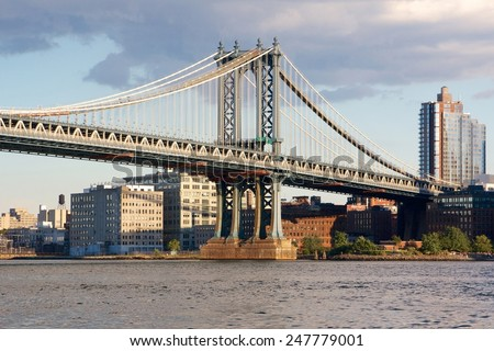 Manhattan Bridge before the Brooklyn waterfront at the East River in New York, NY, USA. - stock photo