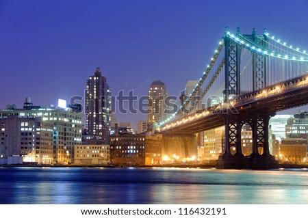 Manhattan bridge in New York at night - stock photo