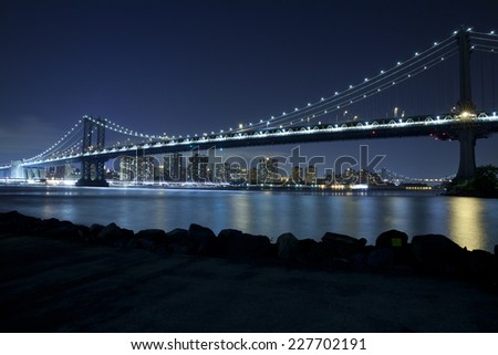 Manhattan Bridge in New York City at night.  View from Dumbo, Brooklyn. - stock photo