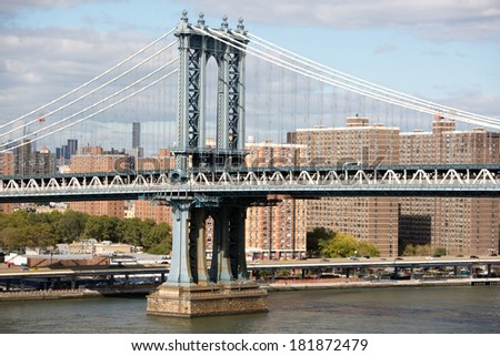 Manhattan bridge in New York City buildings in downtown Manhattan  - stock photo