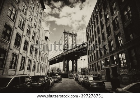 Manhattan bridge seen from a brick buildings in Brooklyn street in perspective, New York, USA. Business and travel background. Vintage, retro postcard with sepia filter. - stock photo
