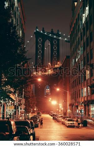 Manhattan Bridge viewed from street at night - stock photo