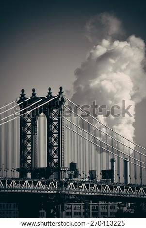 Manhattan Bridge with chimney smoke in New York City - stock photo