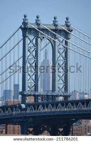 Manhattan Bridge with the Empire State Building in the background. - stock photo