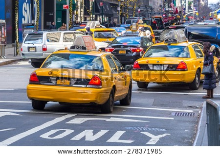 manhattan circa dec 2014 - classic street view of yellow cab in New York city - stock photo