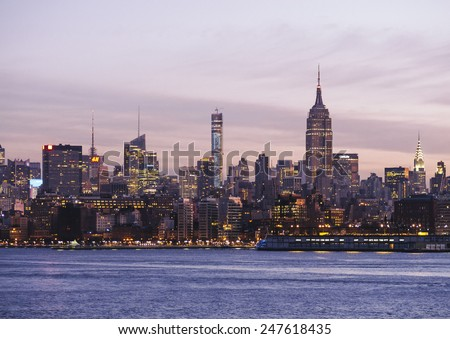Manhattan circa dec 2014: Manhattan skyline and hudson river at sunrise view from new jersey  - stock photo