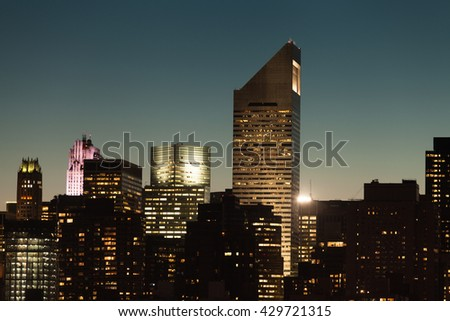 Manhattan cityscape detail with modern skyscrapers and business buildings during twilight in New York City, USA. - stock photo