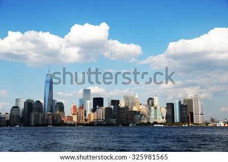 Manhattan cityscape under sunny sky