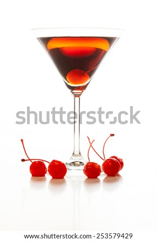 Manhattan cocktail garnished with a cherry on white background - stock photo