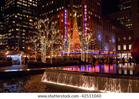 MANHATTAN - DECEMBER 7: Bright holiday lights are a big tourist attraction around Rockefeller Center on December 7, 2009 in New York City. - stock photo