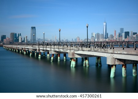 Manhattan downtown skyline and bridge with skyscrapers in New York City. - stock photo