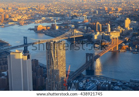 Manhattan downtown sunset rooftop view with urban skyscrapers in New York City - stock photo