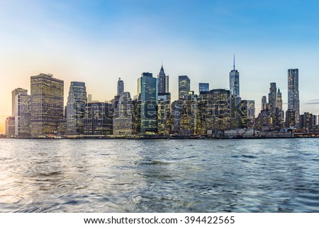 Manhattan Downtown urban view with Brooklyn bridge in sunset - stock photo