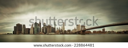 Manhattan financial district with skyscrapers and Brooklyn Bridge. - stock photo