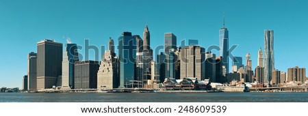 Manhattan financial district with skyscrapers over East River. - stock photo