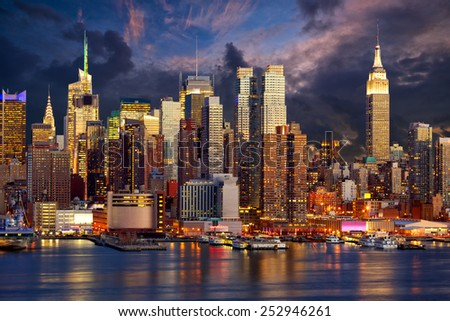 Manhattan Midtown skyline at twilight over Hudson River, New York City - stock photo