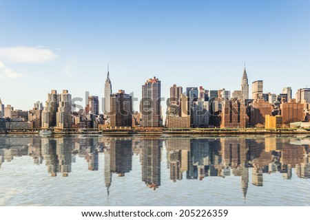 Manhattan midtown skyline panorama over East River in New York. - stock photo