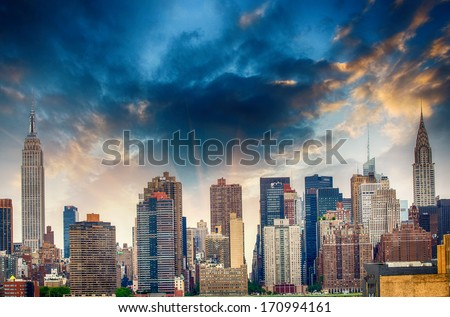 Manhattan midtown skyline panorama over East River with urban skyscrapers and sunset sky in New York City. - stock photo