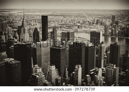 Manhattan midtown view with big skyscrapers, New York City, USA. Skyline panorama. Building tops in financial district. Business black and white background. Vintage, retro postcard with sepia filter.