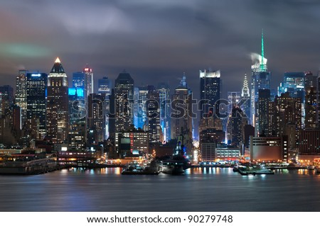 Manhattan, New York City. Manhattan skyline viewed from New Jersey at night.
