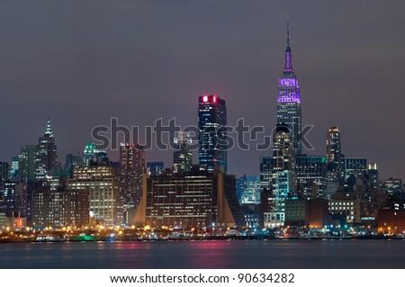 Manhattan, New York City.Manhattan skyline viewed from New Jersey at night. - stock photo