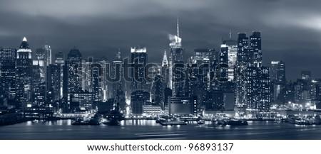 Manhattan, New York City. Panoramic image of Manhattan skyline at night. - stock photo