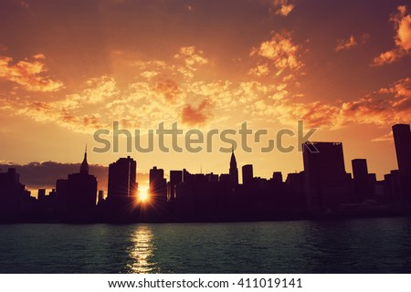 Manhattan, New York City skyline at sunset. View from Long Island City. Urban living, real estate, architecture, travel, career, night life and transportation concept