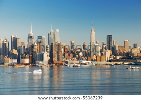 Manhattan, New York City skyline with empire state building over Hudson River. - stock photo