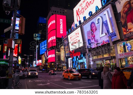 Manhattan, New York, December 20, 2017: Broadway street in Times Square and tourists at night