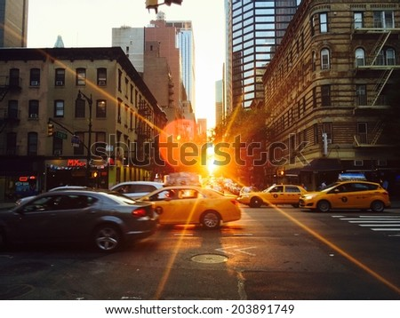 Manhattan, New York - June 19, 2014, 2nd Avenue and 52nd street. Nearing the summer solstice, the setting sun illuminates East-West oriented streets. iPhone photo. - stock photo