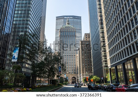 MANHATTAN, NEW YORK - SEPTEMBER 19: View to the Grand Central Terminal and the Met Life Building on September 19, 2015. This view is from the Sixth Avenue, also called the Park Avenue. - stock photo