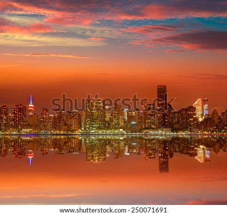 Manhattan New York skyline at sunset dusk from East River NYC USA - stock photo