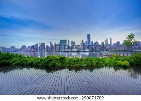 Manhattan New York skyline at sunset from East River dusk USA - stock photo