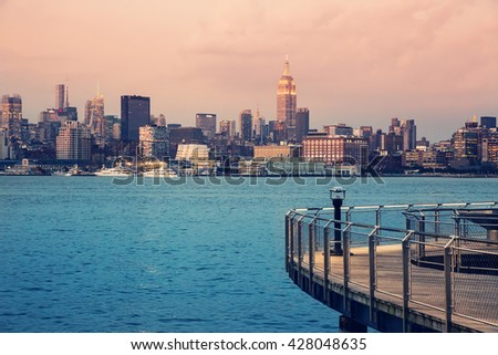 Manhattan, New York skyline. View from Hoboken, New Jersey. Travel, urban, living, life style and transportation concept. Vintage color post processed