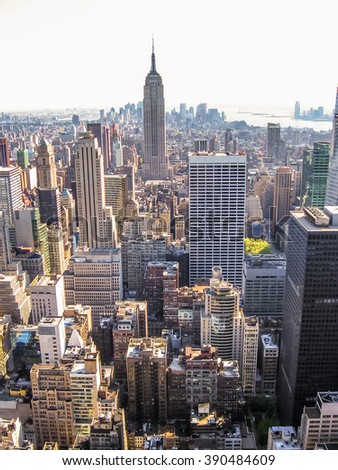 Manhattan, New York, United States - April 29th, 2008: vertical cityscape of New York City from the Top of the Rock at Rockefeller center with Empire State Building - stock photo