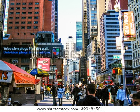 Manhattan, New York, United States - April 29th, 2008: Workers and tourists walk the streets of the City, on the corner Gershwin Way W 50 St.