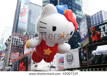 MANHATTAN - NOVEMBER 26: A Hello Kitty balloon passing Times Square at the Macy's Thanksgiving Day Parade NOVEMBER 26, 2009 in Manhattan. - stock photo