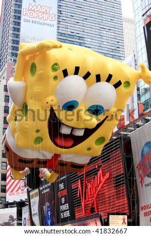 MANHATTAN - NOVEMBER 26 : A Sponge Bob balloon passing Times Square at the Macy's Thanksgiving Day Parade November 26, 2009 in Manhattan. - stock photo