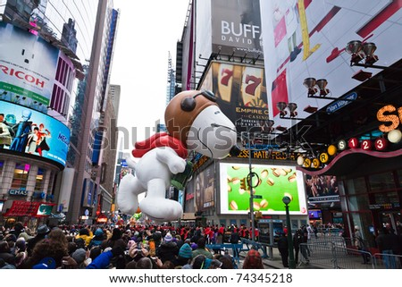 MANHATTAN - NOVEMBER 25 : cartoon character balloon passing Times Square at the Macy's Thanksgiving Day Parade November 25, 2010 in Manhattan. - stock photo