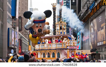 MANHATTAN - NOVEMBER 25 : Mickey Mouse character balloon passes Times Square at the Macy's Thanksgiving Day Parade November 25, 2010 in Manhattan. - stock photo