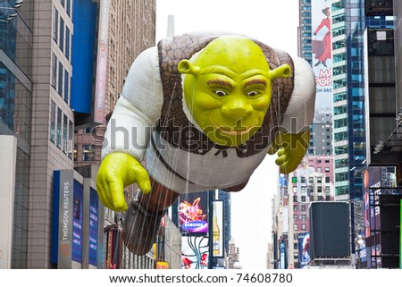 MANHATTAN - NOVEMBER 25 : Shrek character balloon passes Times Square at the Macy's Thanksgiving Day Parade November 25, 2010 in Manhattan. - stock photo