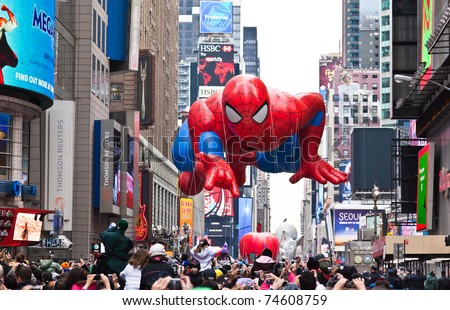 MANHATTAN - NOVEMBER 25 : Spider Man character balloon passes Times Square at the Macy's Thanksgiving Day Parade November 25, 2010 in Manhattan. - stock photo