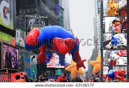MANHATTAN - NOVEMBER 26 : Spiderman balloon passes Times Square at the Macy's Thanksgiving Day Parade November 26, 2009 in Manhattan. - stock photo